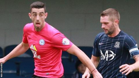 Joe Gormley (left) in action for Peterborough