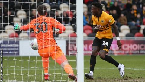 Adebayo Azeez of Newport County scores a goal