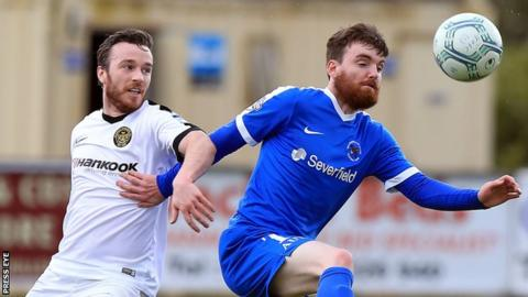 Eamon McAllister of Carrick Rangers in action against Ballinamallard's Gary Armstrong