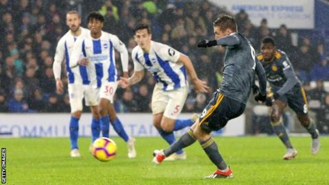 Jamie Vardy scores a penalty in Leicester's 1-1 draw at Brighton.