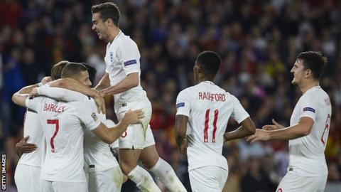 England players celebrate a goal against Spain