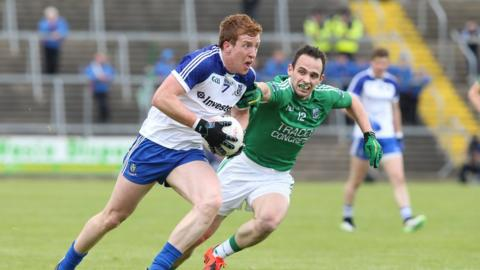 Kieran Duffy carries the ball for Monaghan as Paul McCusker attempts to gain possession for the Erne county