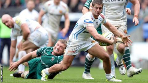 London Irish lock Franco van der Merwe tries to tackle Exeter winger Santiago Cordero