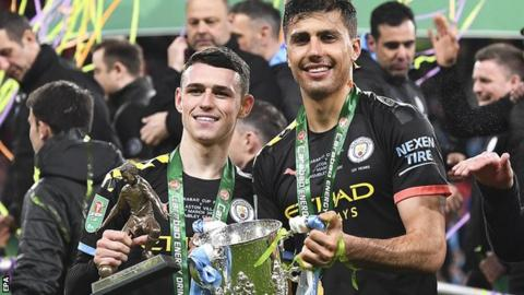 Phil Foden and Rodrigo with the EFL Cup