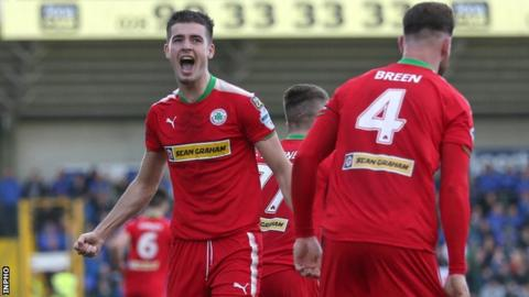 Jay Donnelly scored one of Cliftonville's three goals in the last 10 minutes to beat Linfield 3-2 on 30 September