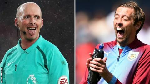 Mike Dean and Peter Crouch