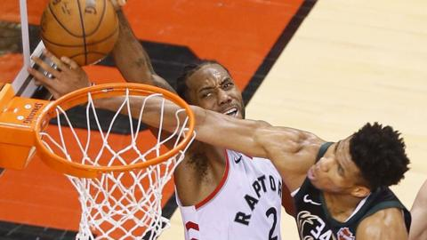 Toronto Raptors' Kawhi Leonard scores against the Milwaukee Bucks