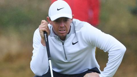 Rory McIlroy surveys a green at Carnoustie