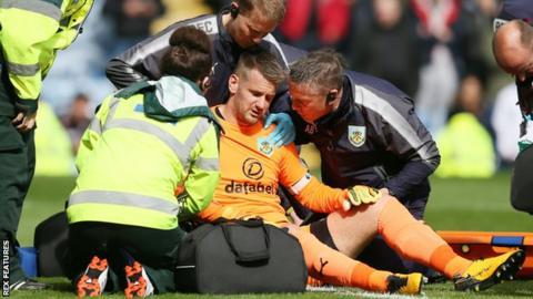 Tom Heaton receives treatment