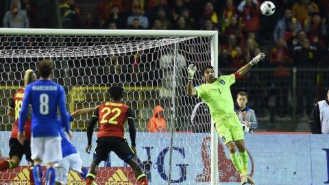 Gianluigi Buffon is beaten by a lob from Belgium's Kevin de Bruyne