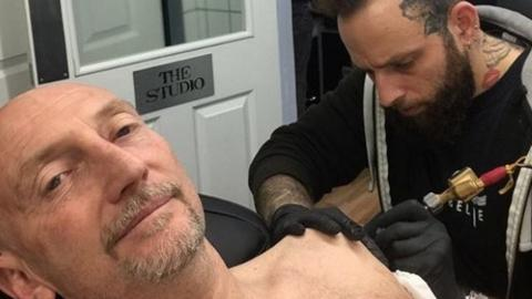 Ian Holloway on Instagram being tattooed by his son Will