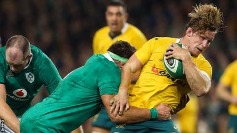Ireland flanker CJ Stander tackles Australian back row Michael Hooper