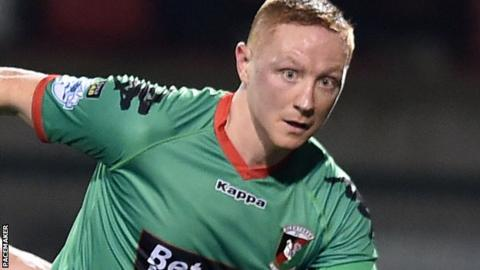 Sport & Leisure's former Glentoran midfielder Stephen McAlorum is believed to have lost a tooth in the incident