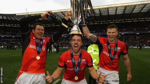 Alex Goode, Chris Wyles and Chris Ashton celebrate Saracens' victory over Clermont Auvergne in the European Champions Cup final