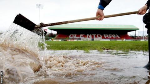 Water is cleared from the Oval pitch earlier this week