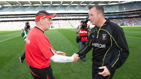 Tyrone manager Mickey Harte shakes hands with opposite number Niall Carew after the Red Hands beat Sligo 0-21 to 0-14