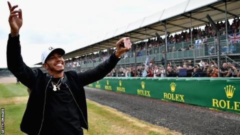 Lewis Hamilton greets fans