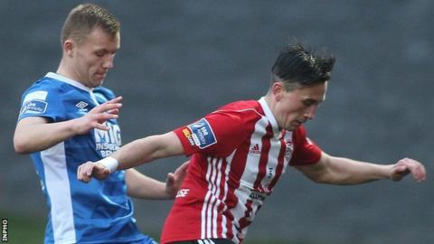 Premier division derry city 2 1 st pats athletic bbc sport aaron mceneff is challenged by jamie lennon at the brandywell publicscrutiny Images