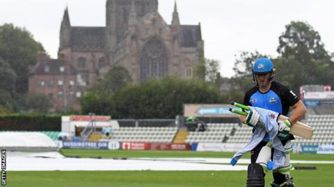 Worcestershire's Ben Cox runs in the rain
