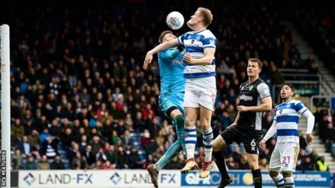 Matt Smith of QPR scores with a header 2-1