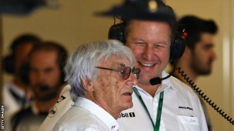 Zak Brown of McLaren talks to F1 boss Bernie Ecclestone