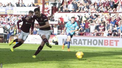 Jamie Walker scores a penalty
