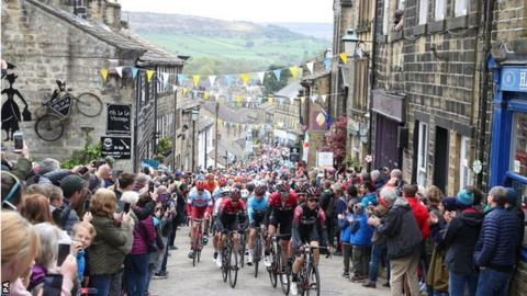 Team Ineos lead the peloton including leader Chris Lawless as they climb a hill in Haworth during stage four of the Tour de Yorkshire.