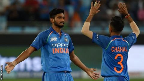 Khaleel Ahmed (left) and Yuzvendra Chahal (right) celebrate after India take a wicket against Hong Kong