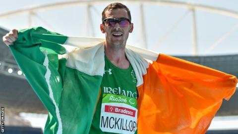 Michael McKillop celebrates clinching the fourth Paralympics gold of his career