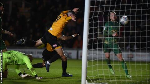 Newport striker Padraig Amond turns in the rebound after his penalty had been saved