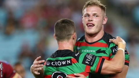 Thomas Burgess celebrates South Sydney's victory over Wigan