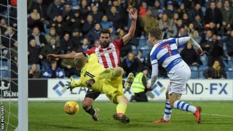 Luke Freeman of QPR scores a goal past Brentford goalkeeper Daniel Bentley