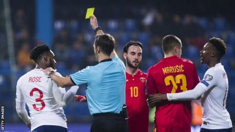 Danny Rose is booked during England's Euro 2020 qualifier in Montenegro