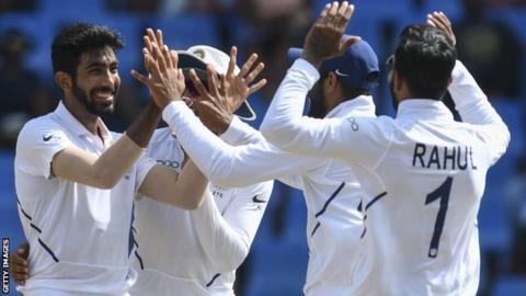 Jasprit Bumrah (left) celebrates with his India team-mates