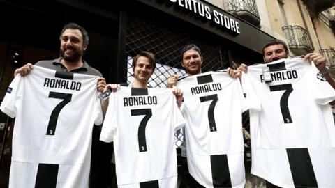 Juventus fans with Ronaldo shirts