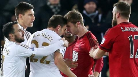 Swansea's Angel Rangel and Callum McManaman of West Brom clash during the Swans' 1-0 win