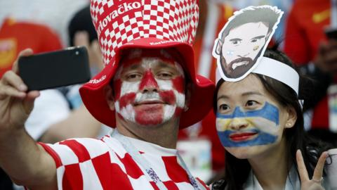 Croatia fan and Argentina fan