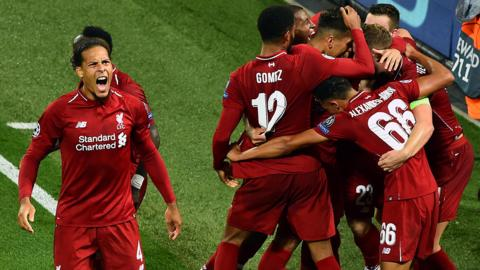 Liverpool's players celebrate scoring against Paris St-Germain