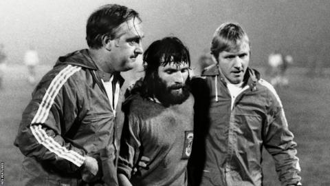 Manager Dave Bowen and trainer Cyril Lea accompany Trevor Hockey, who was sent off in a 3-0 defeat in Poland during Wales' unsuccessful bid to qualify for the 1974 World Cup.