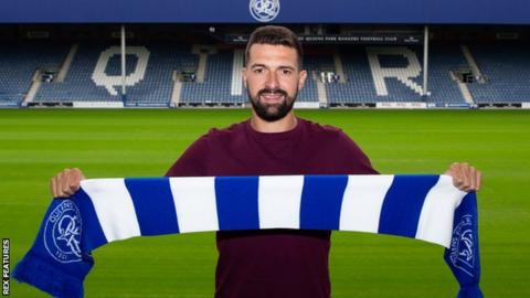 New QPR signing Yoann Barbet poses for pictures at Loftus Road