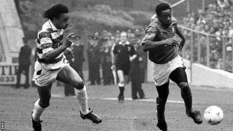 Celtic's Paul Elliott tries to challenge Rangers winger Mark Walters in 1990