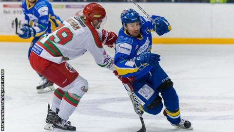 Fife Flyers' Brendan Brooks tries to get past Cardiff Devils defenceman Scott Hotham in Sunday's game