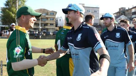 David Warner and Steve Smith shake hands during a domestic cricket game in Australia in November