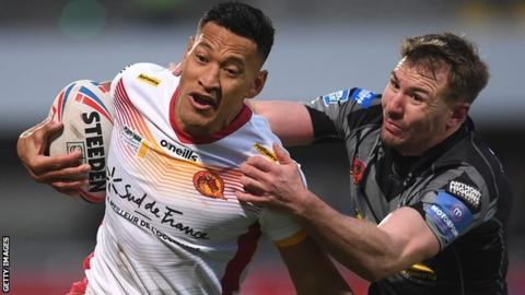 Israel Folau of Catalans Dragons is challenged by Michael Shenton of Castleford Tigers
