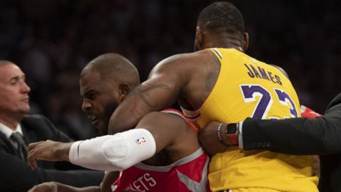 Lebron James pulls Chris Paul away from the melee