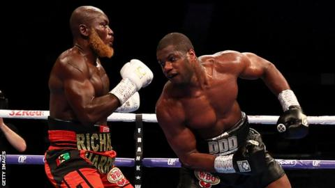 British heavyweight Daniel Dubois (right) lands a blow against Ghana's Richard Lartey (left)