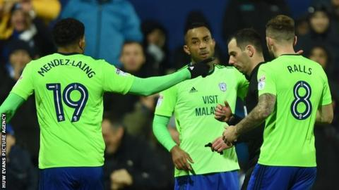 Cardiff City players remonstrate with referee Tim Robinson after he disallowed a Junior Hoilett goal