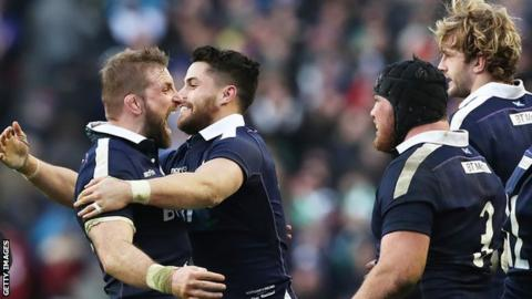 Sean Maitland embraces John Barclay as Scotland celebrate their win over Ireland at Murrayfield