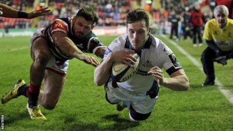 Mark Bennett dives over to score Glasgow's third try
