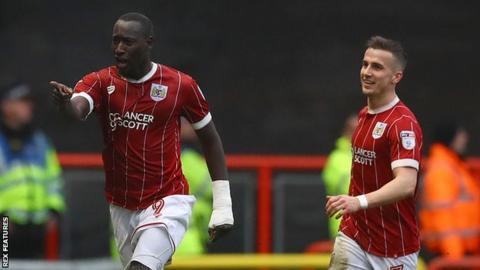 Famara Diedihou celebrates opening the scoring for Bristol City